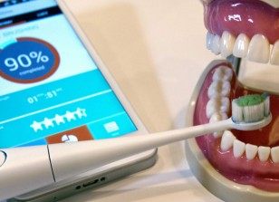 A Kolibree connected electric toothbrush is displayed during the 2014 International Consumer Electronics Show (CES) in Las Vegas, Nevada, January 8, 2014. The smart toothbrush uses an accelerometer, gyroscope and magnetometer to track how well users brush their teeth. The French company expects the toothbrush will be available in the third quarter of 2014 and retail for $99.00 to $199.00 depending on the model. REUTERS/Steve Marcus (UNITED STATES - Tags: BUSINESS SCIENCE TECHNOLOGY)